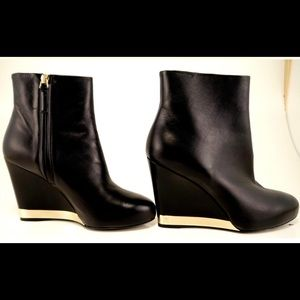 CHANEL black wedge with gold plated logo trim boot